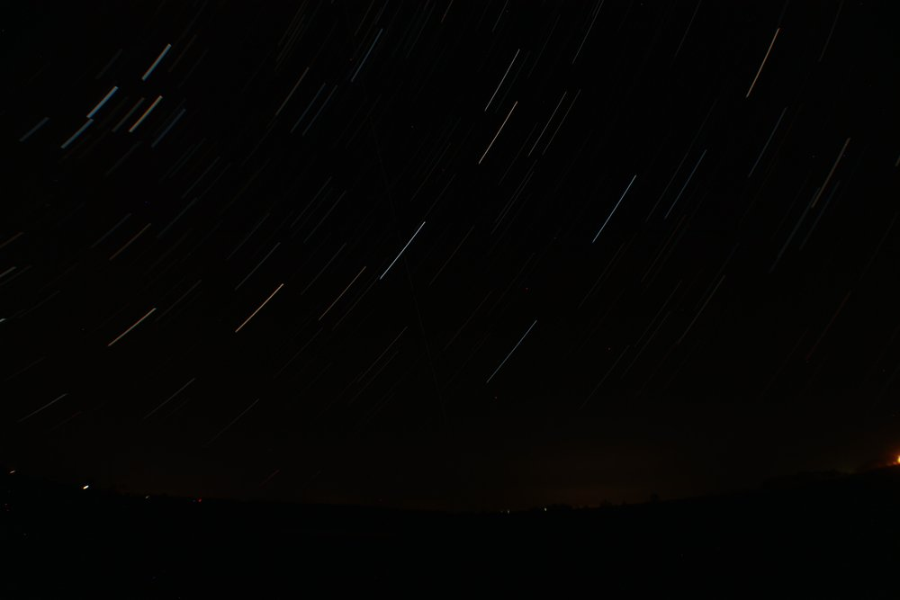 A time-lapse, star-trail photo of Cassiopeia and the Great Square