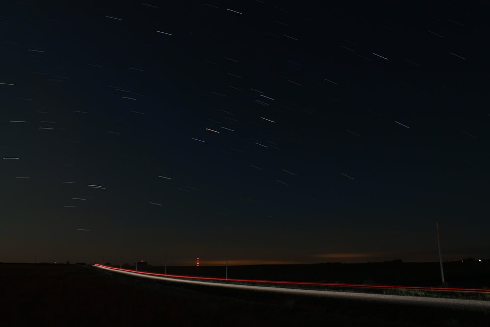 A time-lapse, star-trail photo of Scorpius