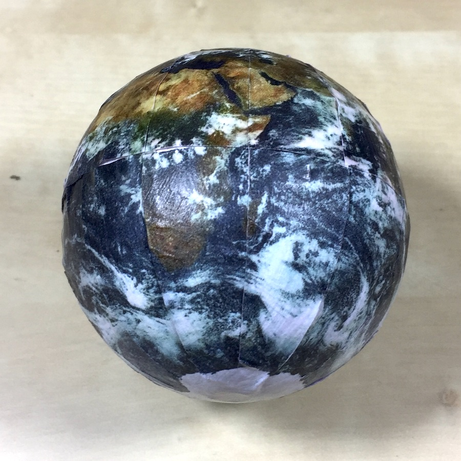 A small globe of the earth, showing physical geography features and cloud cover.