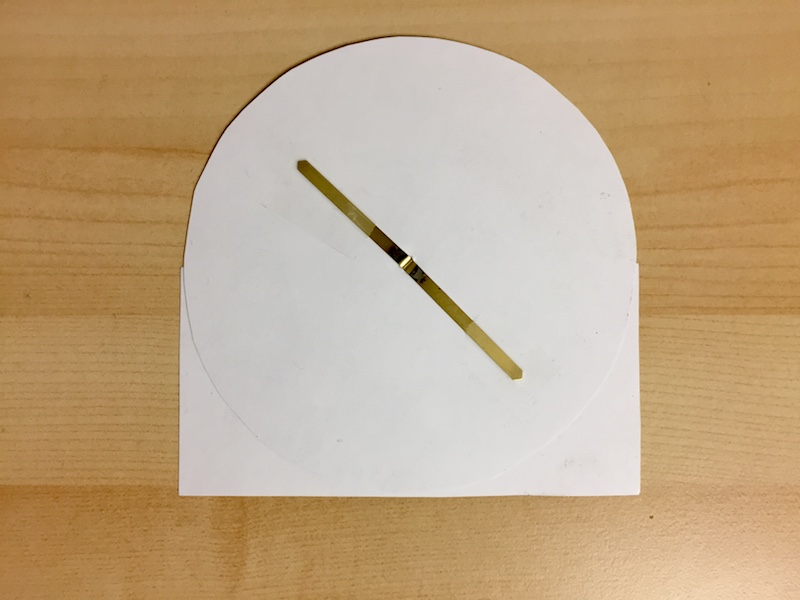 The back side of a paper lunar phase dial