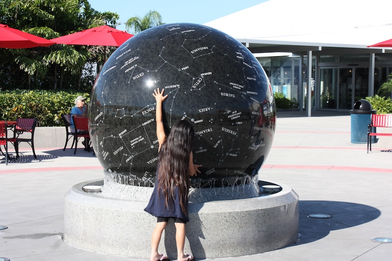 This little girl was playing with the Constellation Sphere. The ball weighs 9 tons, but floats on a fountain that makes it possible for a person to roll it.