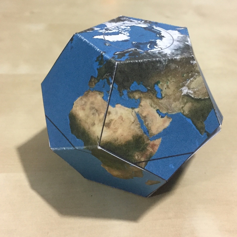 A paper dodecahedron with an image of the earth, making it resemble a globe.