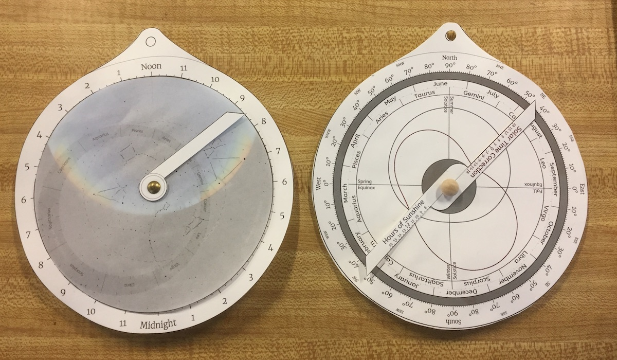 The front and back sides of an educational astrolabe, assembled from cut-out paper parts